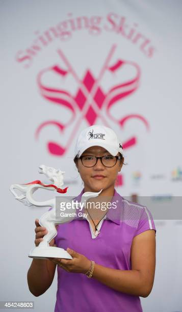 Lydia Ko of New Zealand with the winning score of Eleven under par holds up her the 2013 Swinging Skirts World Ladies Masters trophy during the last...