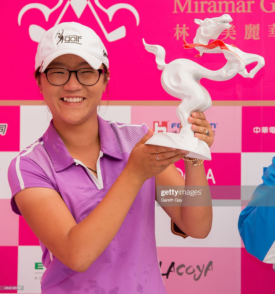 Lydia Ko of New Zealand, with the winning score of Eleven under par, holds up the 2013 Swinging Skirts World Ladies Masters trophy , during the last day of the Swinging Skirts 2013 World Ladies Masters, at Miramar Golf & Country Club on December 8, 2013 in Taipei, Taiwan.