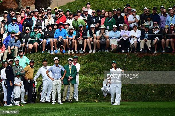 Lydia Ko plays a shot as Kevin Na of the United States Danny Lee of New Zealand and Scott Piercy of the United States look on during the Par 3...