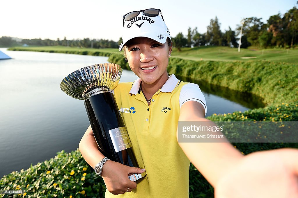 Lydia Ko pretends to take a selfie while holding the trophy on the 18th green after winning 2015 Fubon LPGA Taiwan Championship on October 25, 2015 in Miramar Resort & Country Club Taipei, Taiwan.