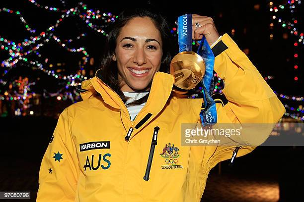 Lydia Lassila of Australia poses with the gold medal for the ladies' aerials freestyle skiing at the Australian Olympic Winter Gold Medal Party on...