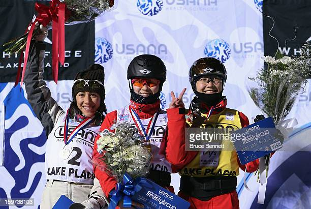 Lydia Lassila of Australia Yu Tang of China and Mengtao Xu of China second place take the podium after the USANA Freestyle World Cup aerial...