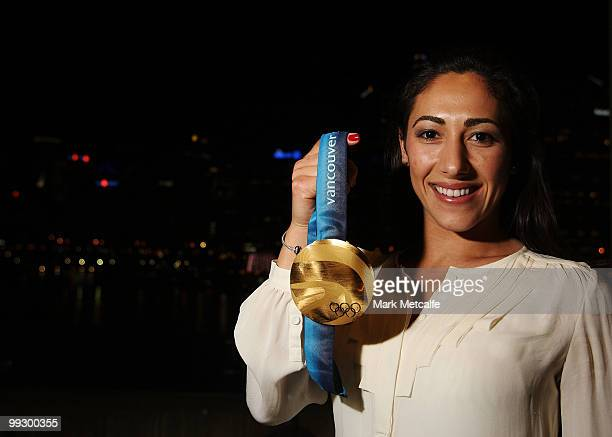 Lydia Lassila poses with an Olympic Gold medal whilst attending the AOC cocktail party to welcome home the 2010 Winter Olympic Team at Sydney...
