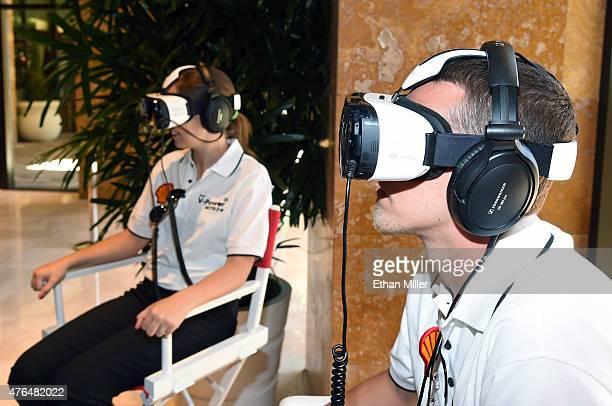 Lydia Penn and Andrew Penn take a 3D engine journey with the Oculus Riftpowered Gear VR headset at the Penske Wynn Ferrari Showroom at Wynn Las Vegas...