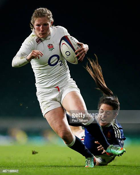 Lydia Thompson of England goes past the tackle from Celine Heguy of France during the Women's Six Nations match between England and France at...
