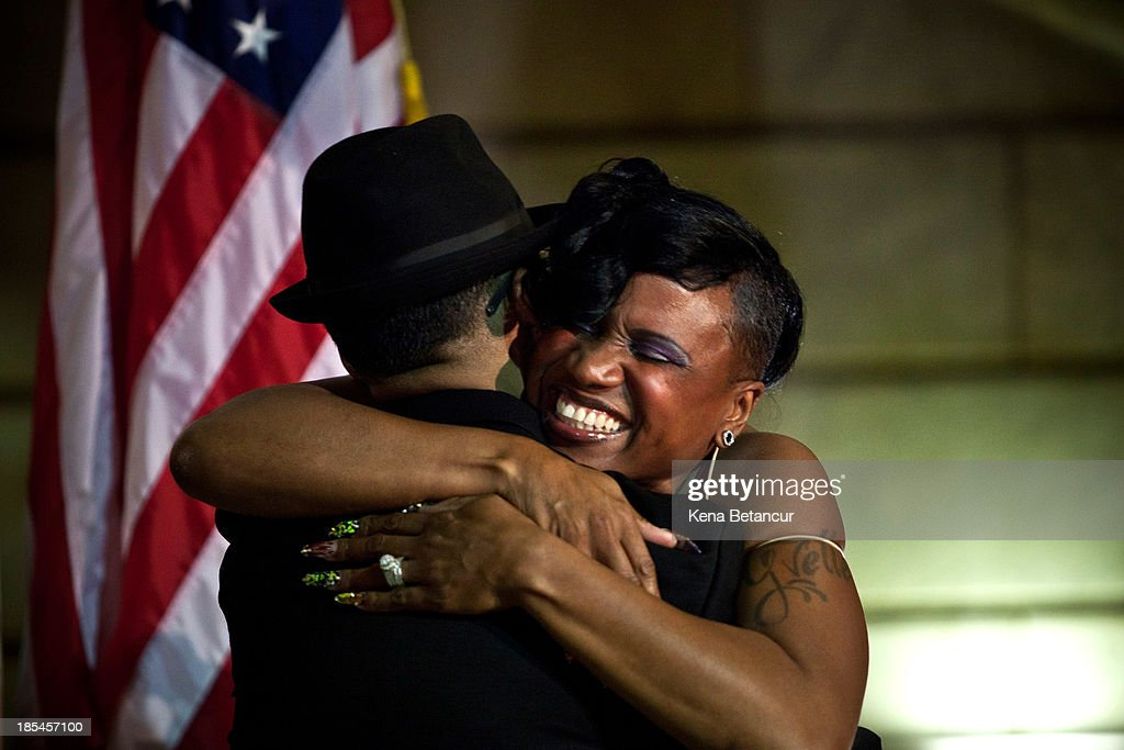 Lydia Torres (L), 44, and Jenelle Torres, 42, hug each other after been married by U.S. Senator-elect Cory Booker at City Hall in the early morning hours of October 21, 2013 in Newark, New Jersey. Same-sex couples were allowed to legally wed at 12:01 am on Monday across New Jersey, making the state the 14th to allow same-sex marriages. Following Friday's ruling by the New Jersey Supreme Court, Mayor Cory A. Booker will marry seven gay, lesbian, and straight couples at City Hall in Newark on Monday morning.