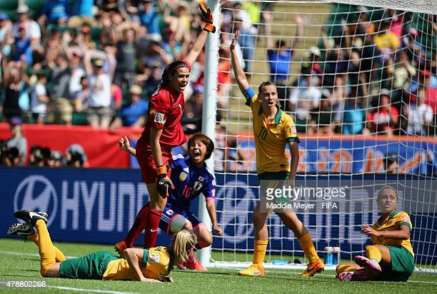 Lydia Williams of Australia and Emily Van Egmond call for a foul as Mana Iwabuchi of Japan celebrates her coal during the FIFA Women's World Cup...
