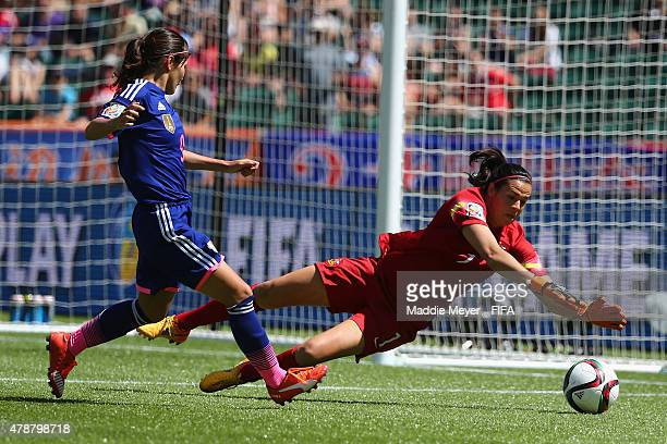 Lydia Williams of Australia saves a shot by Nahomi Kawasumi of Japan during the FIFA Women's World Cup Canada 2015 quarter final match between Japan...