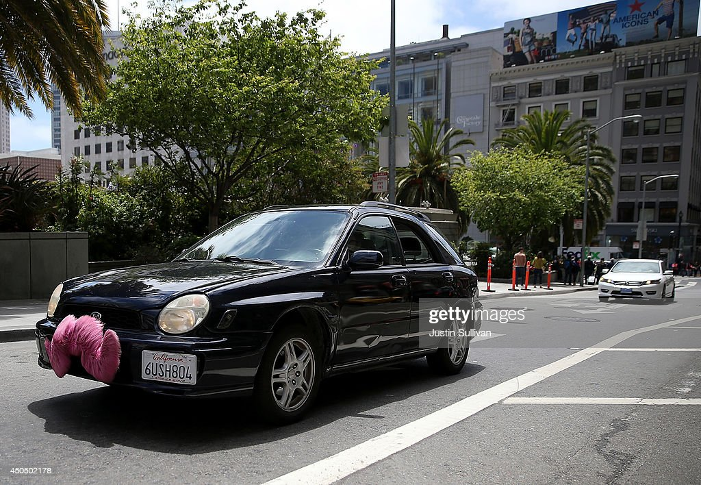 A Lyft car drives along Powell Street on June 12, 2014 in San Francisco, California. The California Public Utilities Commission is cracking down on ride sharing companies like Lyft, Uber and Sidecar by issuing a warning that they could lose their ability to operate within the state if they are caught dropping off or picking up passengers at airports in California.