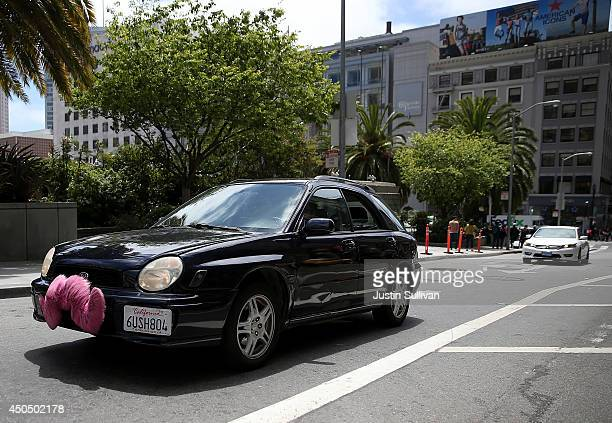 Lyft car drives along Powell Street on June 12 2014 in San Francisco California The California Public Utilities Commission is cracking down on ride...