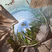Lying at the beach of La Digue from a tiny world perspective