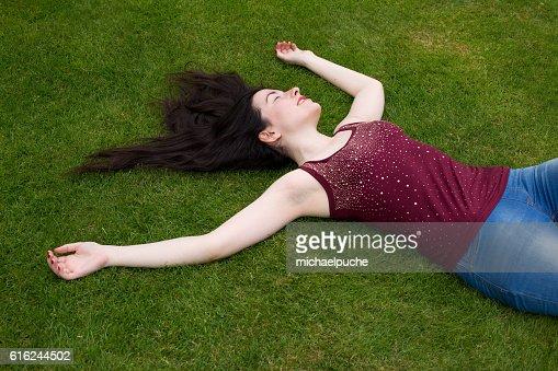 lying in the park : Foto de stock