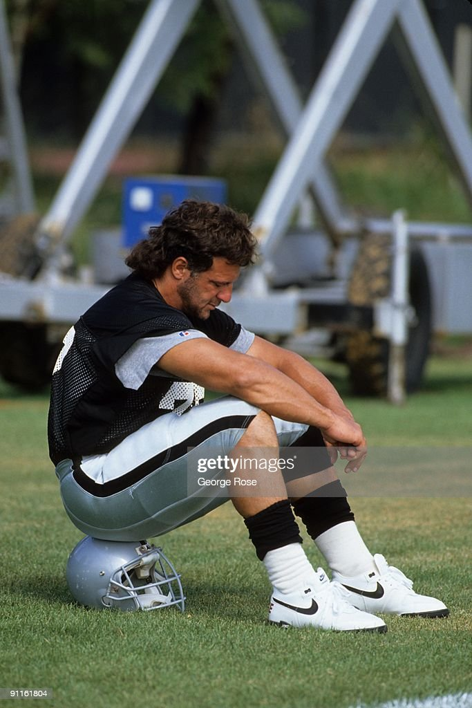 <a gi-track='captionPersonalityLinkClicked' href=/galleries/search?phrase=Lyle+Alzado&family=editorial&specificpeople=544733 ng-click='$event.stopPropagation()'>Lyle Alzado</a> #77 of the Los Angeles Raiders looks on during August of 1990 training camp in Oxnard, California.