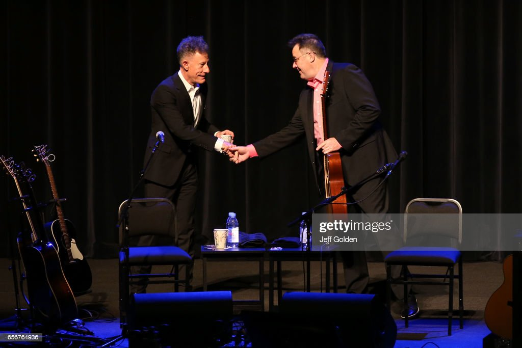 Lyle Lovett (L) shakes hands with Vince Gill as they take the stage to perform in support of their 'Songs and Stories Tour' at Fred Kavli Theatre on March 22, 2017 in Thousand Oaks, California.