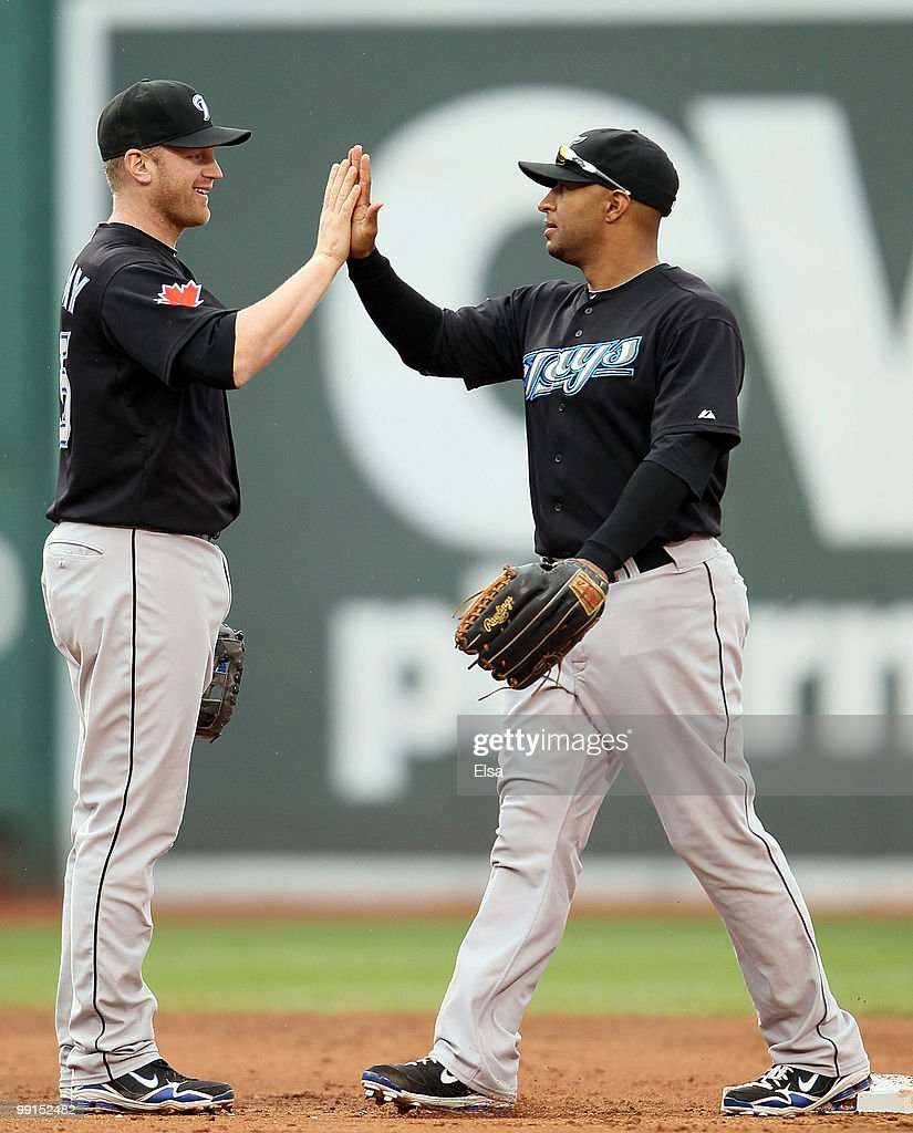 Lyle Overbay and Vernon Wells of the Toronto Blue Jays celebrate the win over the Boston Red Sox on May 12 2010 at Fenway Park in Boston...