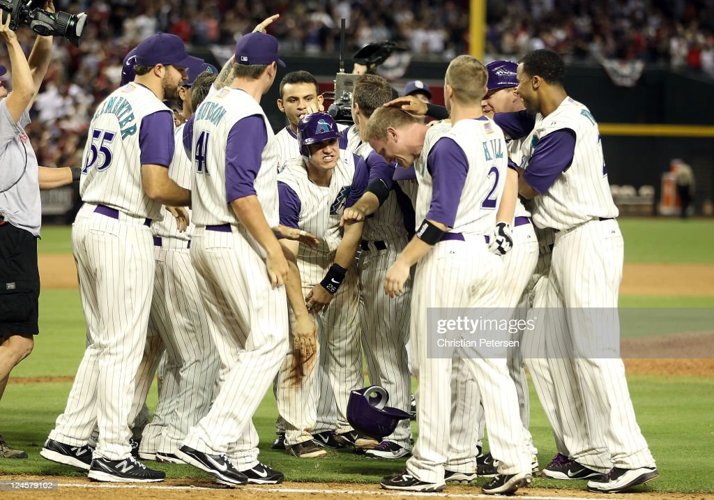 <a gi-track='captionPersonalityLinkClicked' href=/galleries/search?phrase=Lyle+Overbay&family=editorial&specificpeople=214072 ng-click='$event.stopPropagation()'>Lyle Overbay</a> #37 of the Arizona Diamondbacks is congratulated by teammates after a walk off RBI walk against the San Diego Padres during the tenth inning of the Major League Baseball game at Chase Field on September 10, 2011 in Phoenix, Arizona. The Diamondbacks defeated the Padres 6-5 in 10 innings.