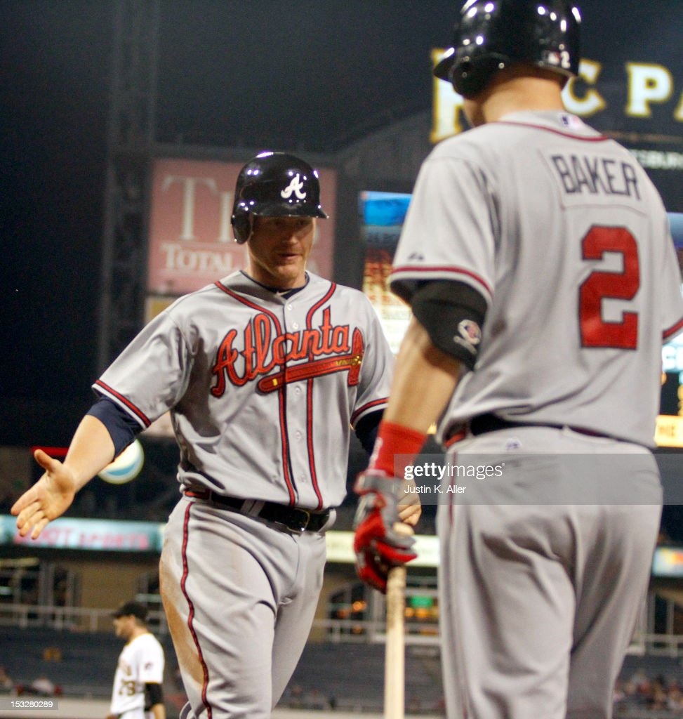 <a gi-track='captionPersonalityLinkClicked' href=/galleries/search?phrase=Lyle+Overbay&family=editorial&specificpeople=214072 ng-click='$event.stopPropagation()'>Lyle Overbay</a> #27 of the Atlanta Braves scores on an RBI double in the fourth inning against the Pittsburgh Pirates during the game on October 2, 2012 at PNC Park in Pittsburgh, Pennsylvania.