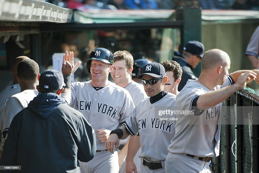 <a gi-track='captionPersonalityLinkClicked' href=/galleries/search?phrase=Lyle+Overbay&family=editorial&specificpeople=214072 ng-click='$event.stopPropagation()'>Lyle Overbay</a> #55 of the New York Yankees celebrates in the dugout after scoring during the sixth inning against the Cleveland Indians during the second game of a doubleheader at Progressive Field on May 13, 2013 in Cleveland, Ohio.