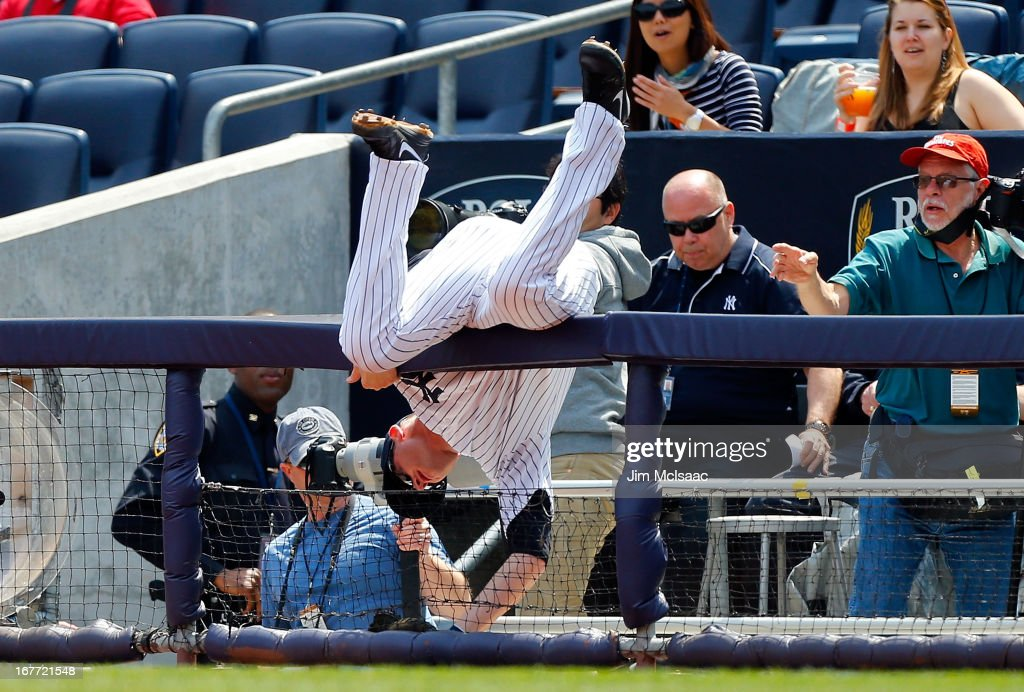 <a gi-track='captionPersonalityLinkClicked' href=/galleries/search?phrase=Lyle+Overbay&family=editorial&specificpeople=214072 ng-click='$event.stopPropagation()'>Lyle Overbay</a> #55 of the New York Yankees keeps himeself from falling into the photo well trying to catch a foul ball in the first inning against the Toronto Blue Jays at Yankee Stadium on April 28, 2013 in the Bronx borough of New York City.