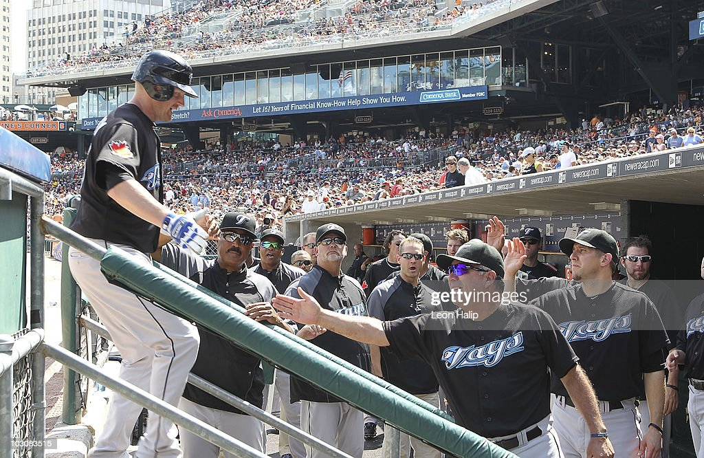 Lyle Overbay #35 of the Toronto Blue Jays celebrates his ninth inning game winning two run home run with his teammates in the dugout during the game against the Detroit Tigers on July 25, 2010 at Comerica Park in Detroit, Michigan. The Blue Jays defeated the Tigers 5-3.