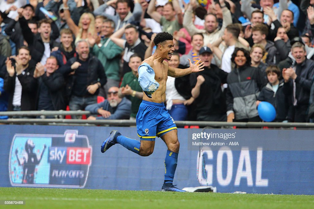 Lyle Taylor of AFC Wimbledon celebrates after scoring a goal to make it 1-0 during the Sky Bet League Two Play Off Final between Plymouth Argyle and AFC Wimbledon at Wembley Stadium on May 30, 2016 in London, England.