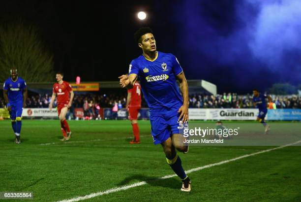 Lyle Taylor of AFC Wimbledon celebrates after scoring the second goal during the Sky Bet League One match between AFC Wimbledon and Milton Keynes...