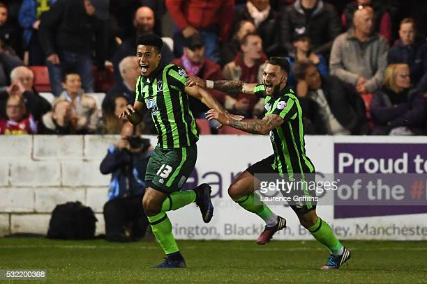 Lyle Taylor of AFC Wimbledon celebrates with teammate Callum Kennedy after scoring a goal in the first period of extra time to give his team a 32...