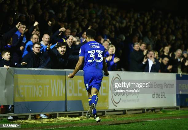 Lyle Taylor of AFC Wimbledon celebrates with the fans after scoring the second goal during the Sky Bet League One match between AFC Wimbledon and...