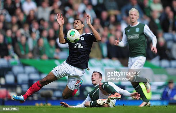 Lyle Taylor of Falkirk battles with Paul Hanlon of Hibernian during The William Hill Scottish Cup Semi Final between Falkirk and Hibernian at Hampden...