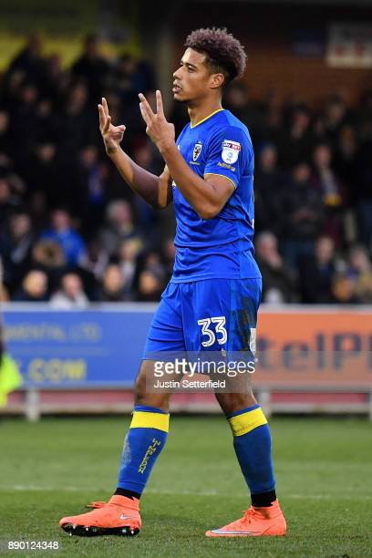 Lyle Taylor of Wimbledon celebrates scoring during the Emirates FA Cup Second Round match between AFC Wimbledon and Charlton Athletic at The Cherry...