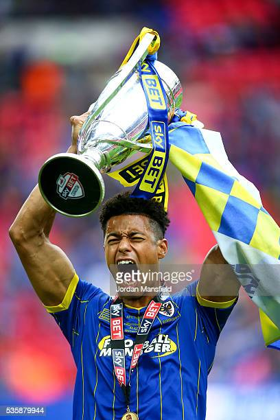 Lyle Taylor of Wimbledon lifts the trophy after their victory in the Sky Bet League Two Play Off Final match between Plymouth Argyle and AFC...