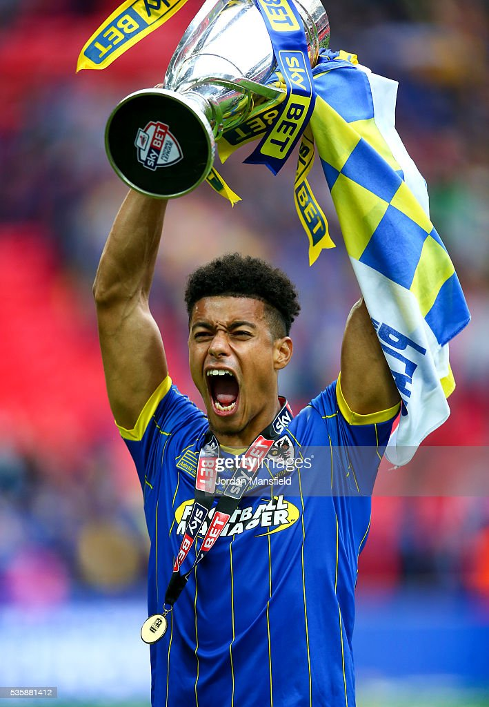 Lyle Taylor of Wimbledon lifts the trophy after their victory in the Sky Bet League Two Play Off Final match between Plymouth Argyle and AFC Wimbledon at Wembley Stadium on May 30, 2016 in London, England.