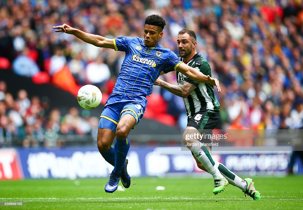 Lyle Taylor of Wimbledon tackles with <a gi-track='captionPersonalityLinkClicked' href=/galleries/search?phrase=Carl+McHugh&family=editorial&specificpeople=9932212 ng-click='$event.stopPropagation()'>Carl McHugh</a> of Plymouth during the Sky Bet League Two Play Off Final match between Plymouth Argyle and AFC Wimbledon at Wembley Stadium on May 30, 2016 in London, England.