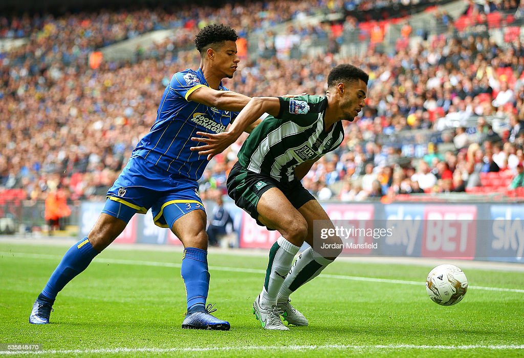 Lyle Tayor of Wimbledon tackles with Curtis Nelson of Plymouth during the Sky Bet League Two Play Off Final match between Plymouth Argyle and AFC Wimbledon at Wembley Stadium on May 30, 2016 in London, England.