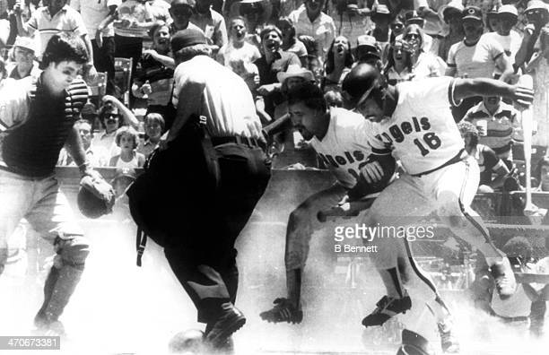 Lyman Bostock of the California Angels and teammate Ron Jackson protest after umpire Terry Cooney called Bostock out as catcher Jim Sundberg of the...