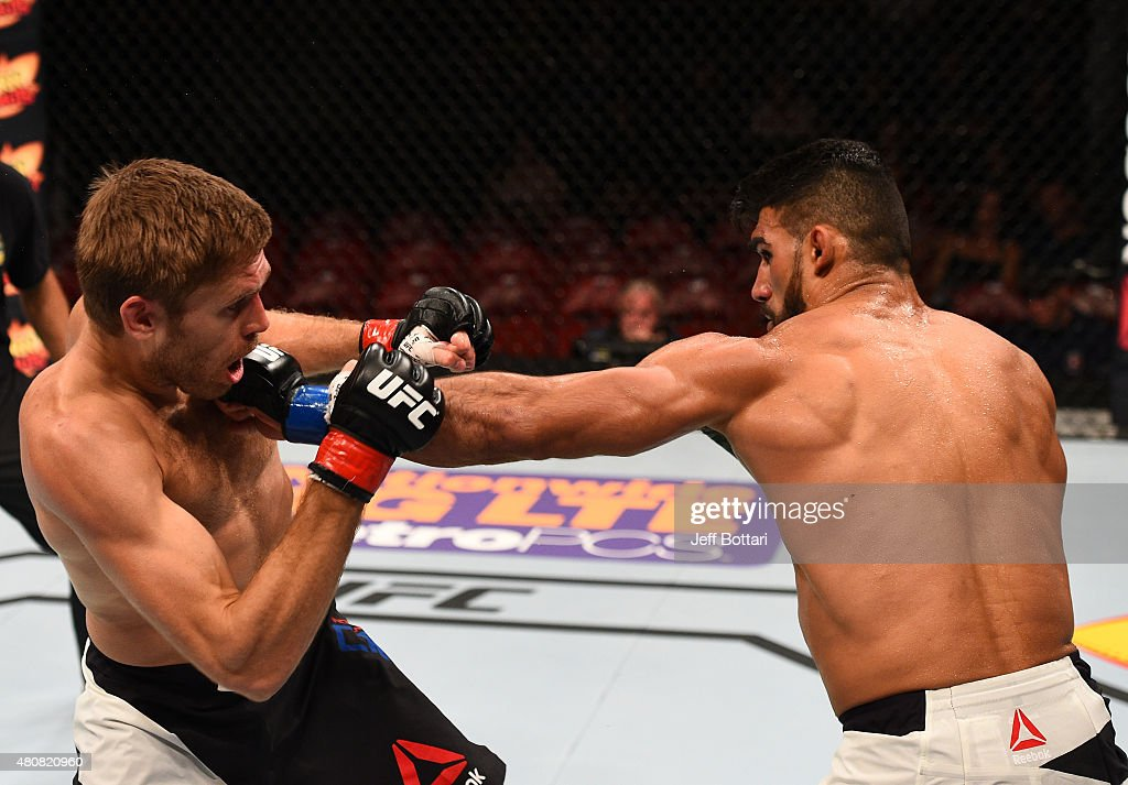 Lyman Good punches Andrew Craig in their middleweight bout during the UFC event at the Valley View Casino Center on July 15, 2015 in San Diego, California.