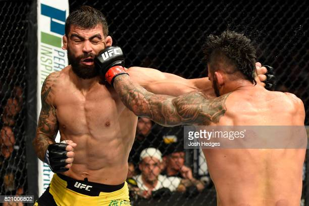 Lyman Good punches Elizeu Zaleski dos Santos of Brazil in their welterweight bout during the UFC Fight Night event inside the Nassau Veterans...
