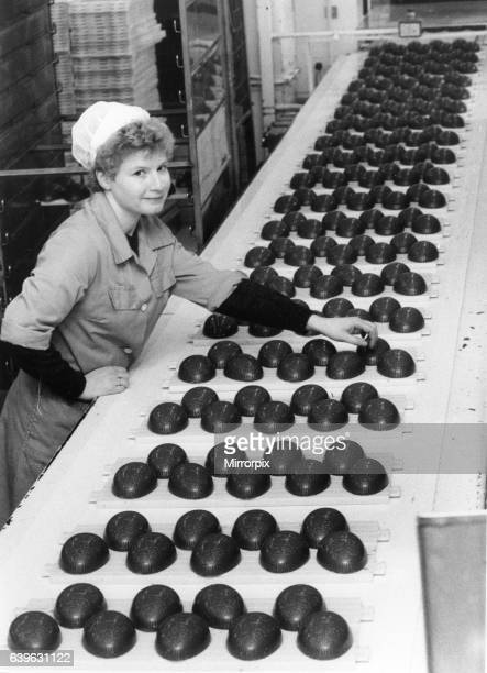 Lyn Hamblin takes trays of half Easter eggs off the conveyor ready for filling and wrapping at Cadbury Birmingham 4th January 1984
