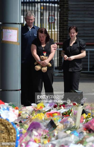 Lyn Rigby mother of Drummer Lee Rigby holding a teddy bear joins other family members as they look at floral tributes outside Woolwich Barracks as...