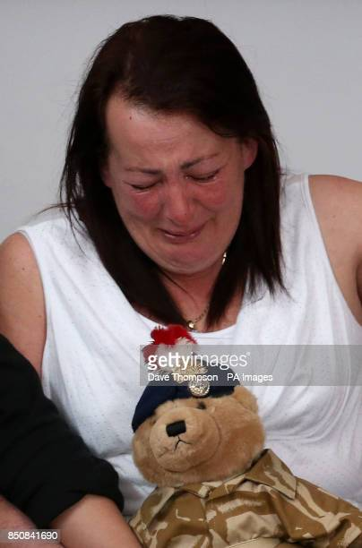 Lyn Rigby the mother of murdered soldier Lee Rigby holds a teddy bear bought by Lee for his son Jack during a press conference at the Regimental HQ...