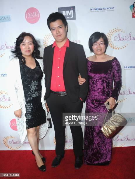 Lyn Tang Yu Tang and Song Zhao at Sai Suman's Official Hollywood Runway Fashion Show held at Sofitel Hotel on April 11 2017 in Los Angeles California