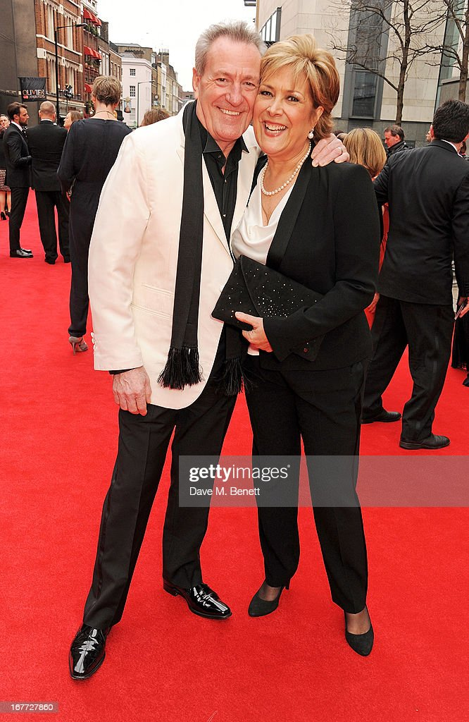 Lynda Bellingham (R) and Michael Pattemore arrive at The Laurence Olivier Awards 2013 at The Royal Opera House on April 28, 2013 in London, England.