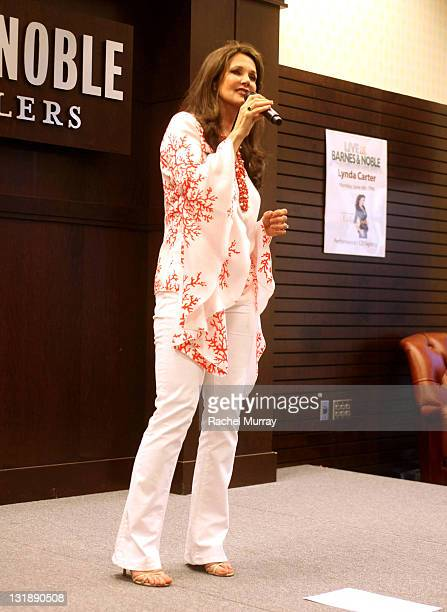 Lynda Carter sings onstage during a special performance and CD signing for 'Crazy Little Things' at Barnes Noble bookstore at The Grove on June 6...