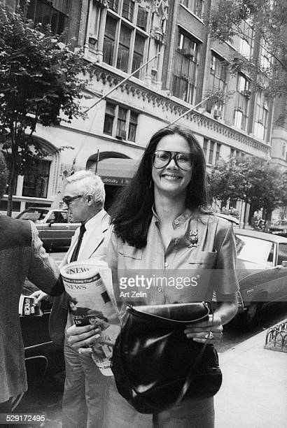 Lynda Carter walking on the street with The Daily News circa 1970 New York