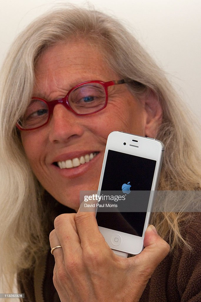 Lynda Malavanya holds her new white iPhone 4 at the Apple store April 28, 2011 in Palo Alto, California. The long awaited white iPhone, first announced in June of 2010, went on sale worldwide for the first time today.