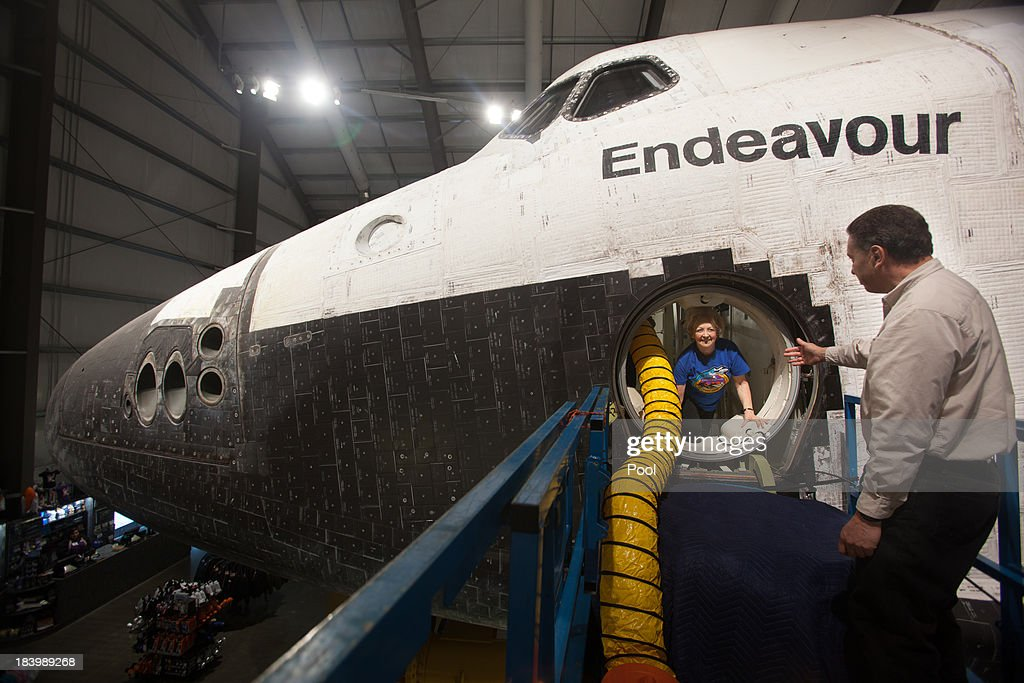 Lynda Oschin (L) is helped out of the Endeavour after a tour with CSC president Jeffrey Rudolph, celebrating the one year anniversary of Endeavour's journey through the street of Los Angeles, on October 10, 2013 in Los Angeles, California. Oschin, whose foundation helped to bring the shuttle to Los Angeles, formed the Mr. and Mrs. Samuel and Lynda Oschin Foundation, formed in honor of Oschin's late husband, a Los Angeles businessman and philanthropist.