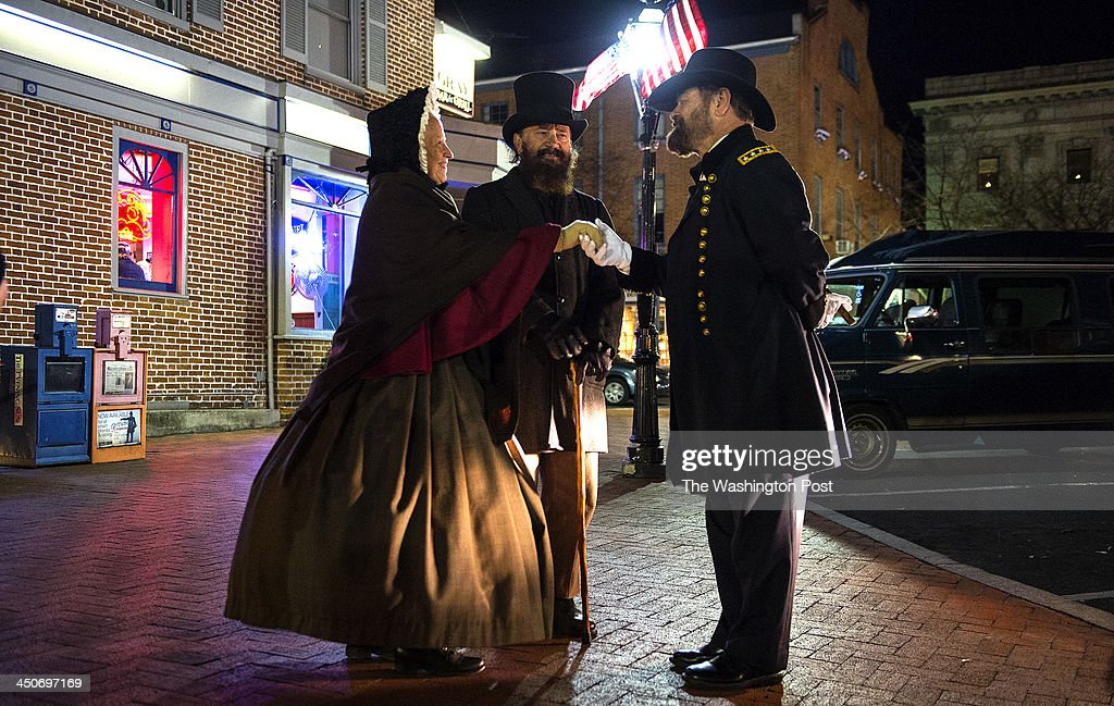 Lynda Pennell (left ) and Gene Pennell dressed as Union LT. General James Longstreet (center) are greeted by Larry Clowers (right) dressed as General Ulysses S. Grant on November 18, 2013 in Gettysburg, Pennsylvania. The three participated in 'A Living History through Town. event in civil war period dress on the eve of the 150TH Anniversary of President Lincoln's Gettysburg address