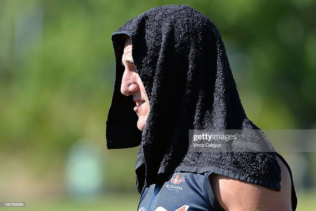 Lynden Dunn cools down with a wet towel on his head during a Melbourne Demons AFL training session at Gosch's Paddock on February 6, 2013 in Melbourne, Australia.
