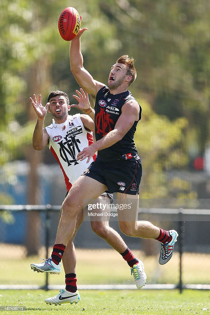Lynden Dunn marks the ball during a Melbourne Demons AFL training session at Gosch's Paddock on February 7, 2014 in Melbourne, Australia.
