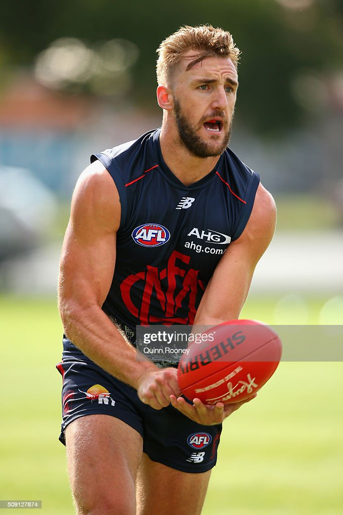 Lynden Dunn of the Demons handballs during a Melbourne Demons AFL pre-season training session at Gosch's Paddock on February 9, 2016 in Melbourne, Australia.